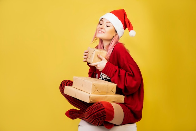 Satisfied girl with red santa suit