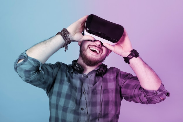 Satisfied man in glasses of virtual reality
