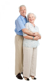 Satisfied smiling senior couple standing full length together isolated on white