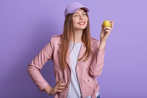 Satisfied student girl wearing casual clothing and cap