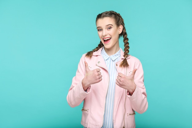 Satisfied thumbs up portrait of beautiful cute girl standing