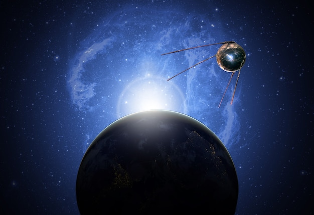 Sattelite in space above earh is orbiting the planet future technology b. elements of this image furnished by nasa