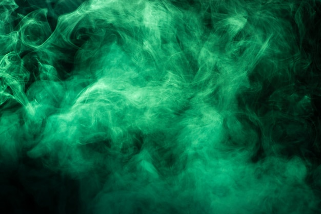Saturated green smoke texture on black
