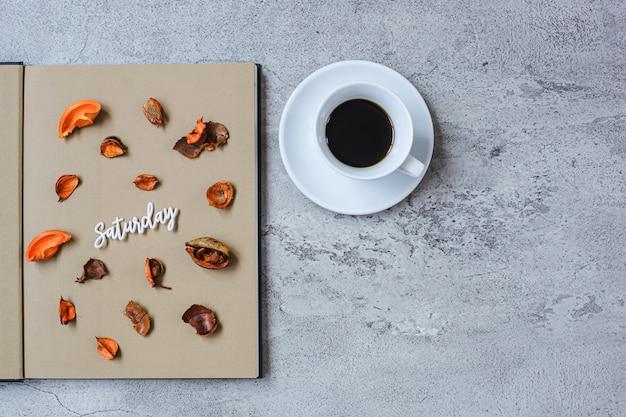 Saturday flat lay minimalist autumn concept with copy spac