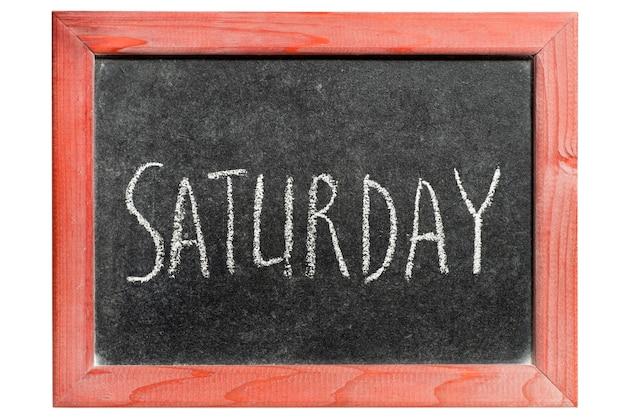 고립 된 빈티지 칠판에 필기하는 토요일 단어 프리미엄 사진