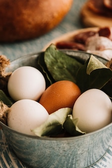 Saucepan with eggs and bay leaves