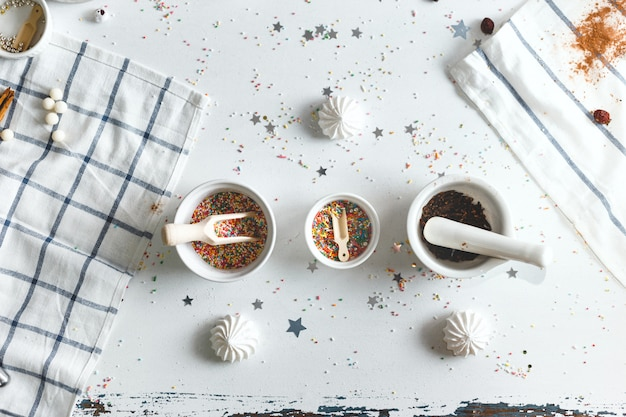 Saucer with candy sprinkles and sweets