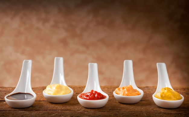 Sauces mixed in the ceramic spoons