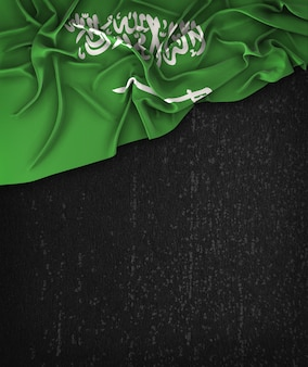 Saudi arabia flag vintage on a grunge black chalkboard with space for text