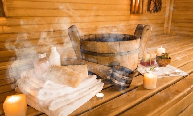 Sauna and sauna accessories on an interior background