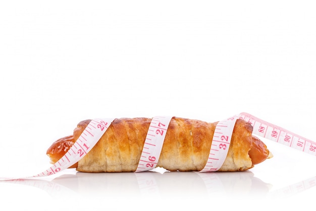 Sausage bread and measurement tape