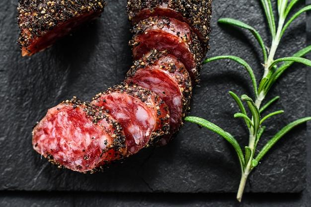 Sausage fuet. pork sausage. italian antipasto