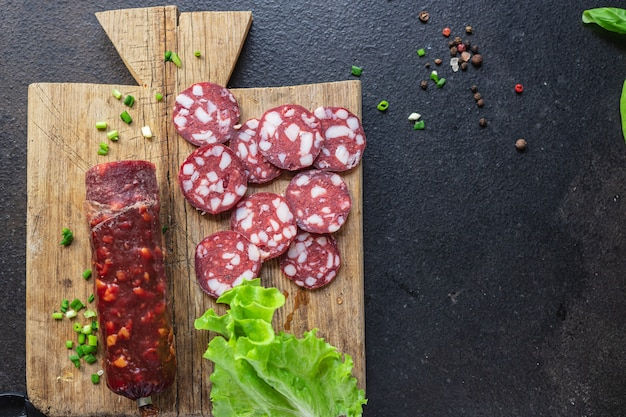 Sausage meat pieces lard bacon beef or pork smoked or drycured meal snack on the table copy space