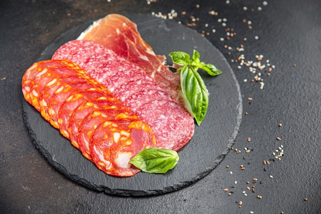 Sausage meat slice assorted slicing salami chorizo jamon prosciutto fresh meal snack on the table