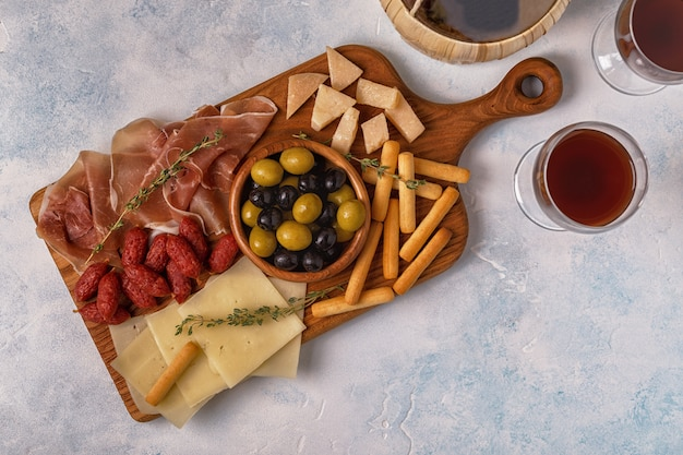 Sausage, olives, prosciutto, breadsticks, and wine