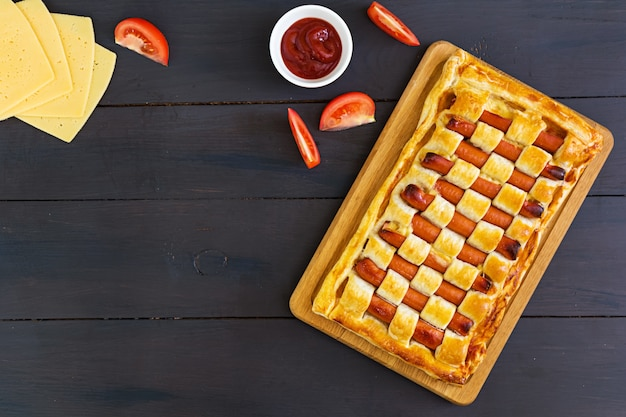 Sausage pie in puff pastry