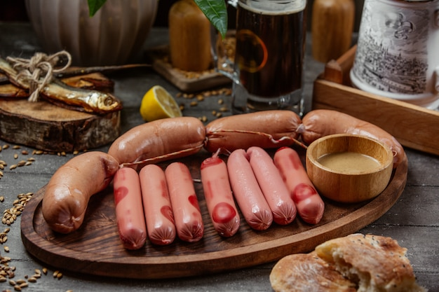 Sausage set on wooden board