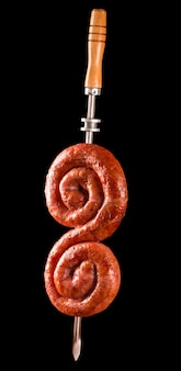 Sausage in the spit, traditional brazilian barbecue.