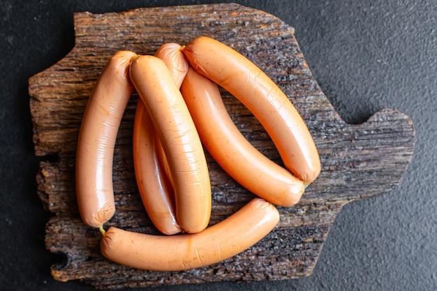 Колбаса растительный белок сейтан постный соевый пшеница вегетарианская или веганская закуска на столе здоровая