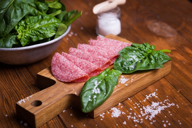 Sausage with fresh spinach