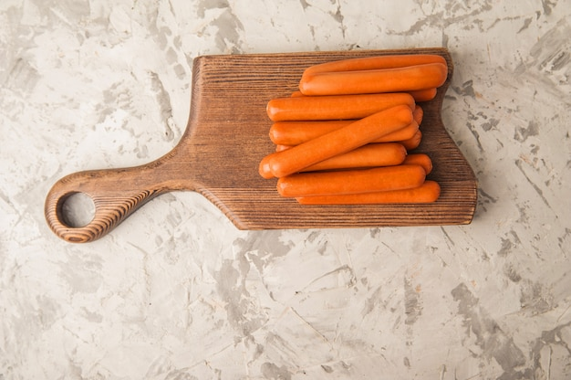 . sausages on the blackboard and place for text. boiled raw bavarian sausages and copy space.