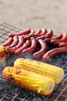 Sausages and corn on the grill