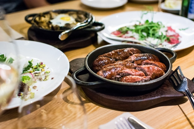 Sausages on a hot pan in a restaurant