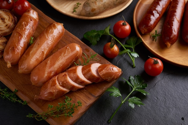 Sausages and ingredients for cooking. grilled sausage with the addition of herbs and and spices