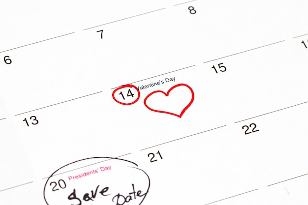 Save the date written on the calendar - 28 february and 14 february, outlined in black and red marker