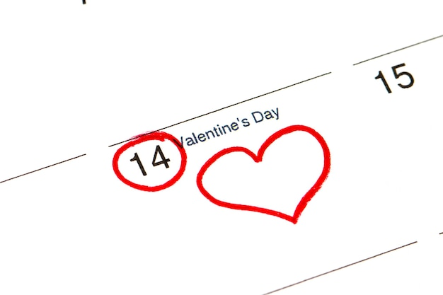 Save the date written on the calendar - february 14, outlined in black and red marker