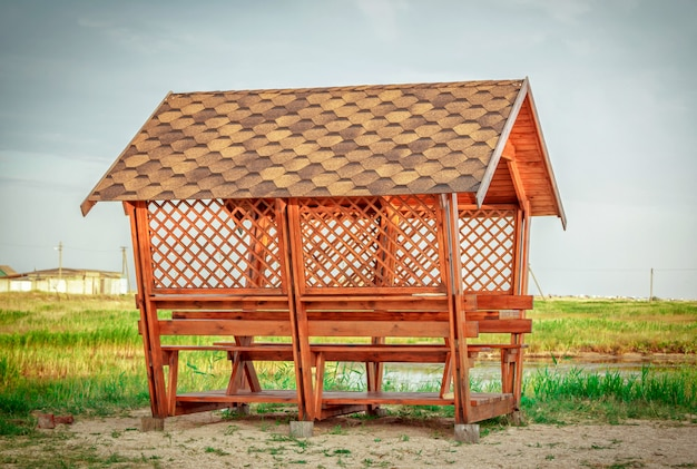 Save download preview new wooden gazebo on a pond sandy coast