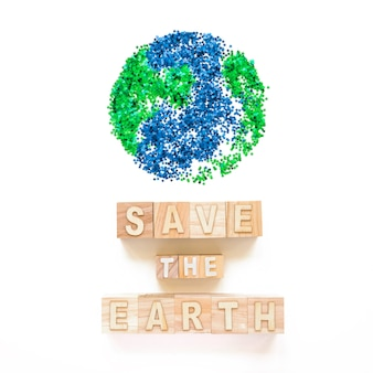 Save the earth words on cubes and planet symbol
