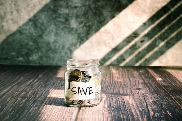 Save money, coins in glass jar for money saving financial concept