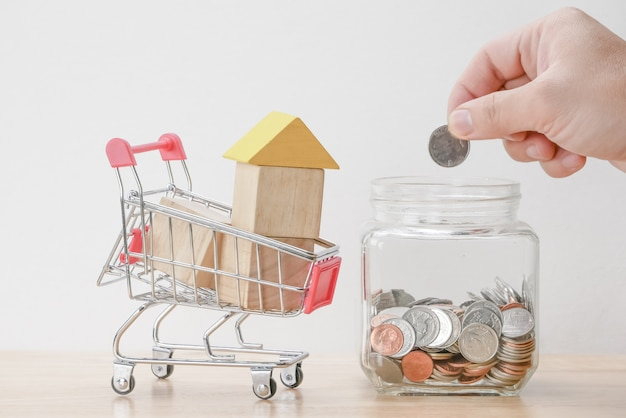 Save money for investment mortgage concept by wood block house