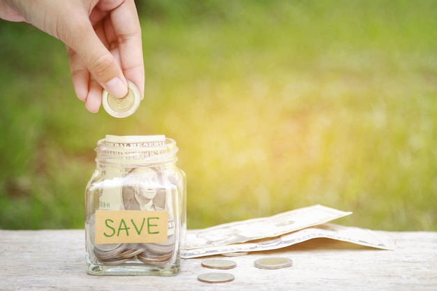 Save money in saving bottle for good living life