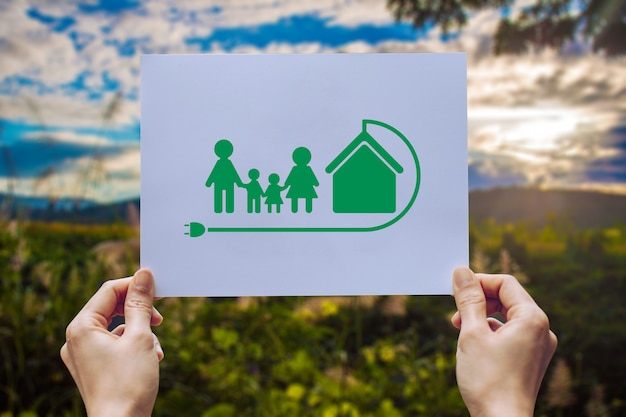 Save world ecology  environmental conservation with hands holding cut out paper earth loving ecology family showing