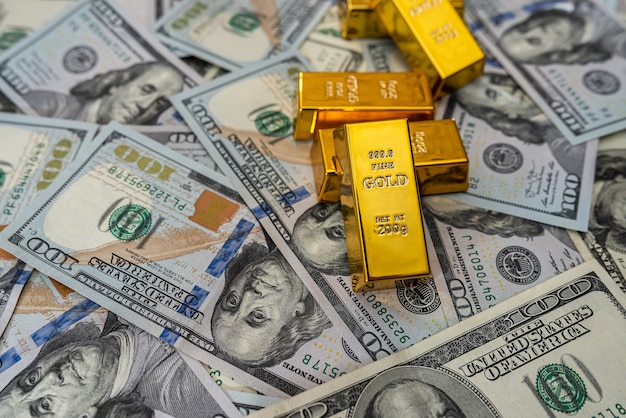 Saving concept dollar bills with gold bar