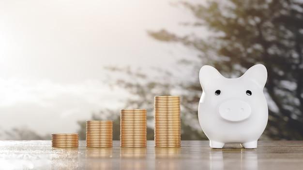 저축 돈 개념 돈 동전 스택과 함께 돼지 저금통 긍정적인 소득 성장