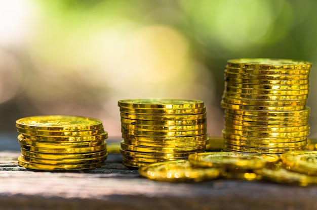 Saving money concept and save money to support everything in life with sun light bokeh background