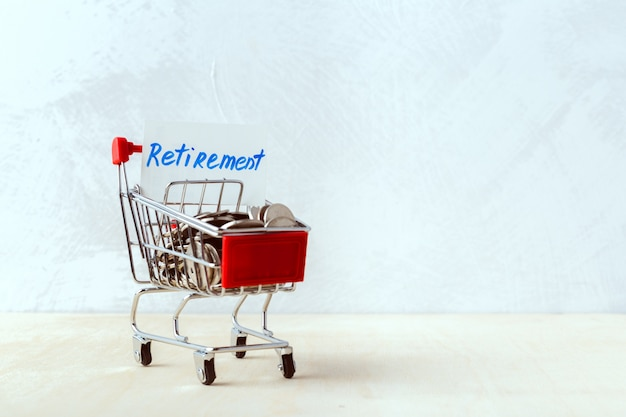 Saving money concept. shopping trolley or cart with coin