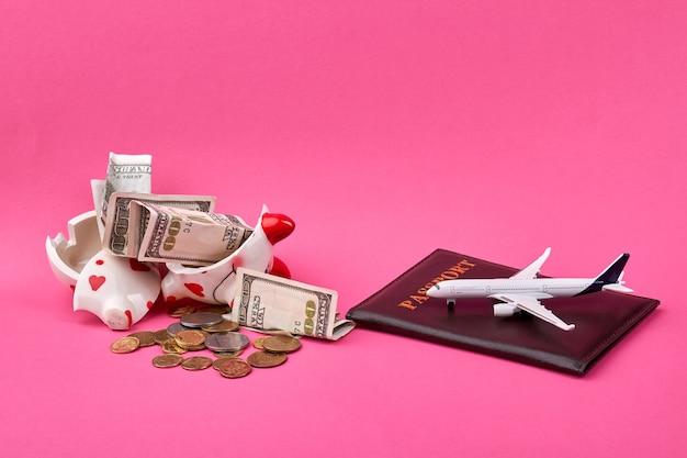 Saving money for travel concept with broken piggy bank