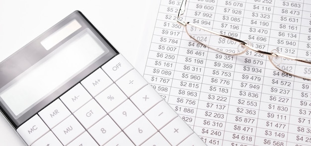 Saving stack coins money, calculator, charts and graphs spreadsheet paper