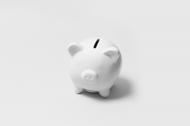 Savings, income concept. gray piggy bank on a gray background. minimal composition.