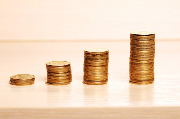 Savings, increasing columns of coins with white