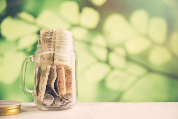 Savings jar on blurred background