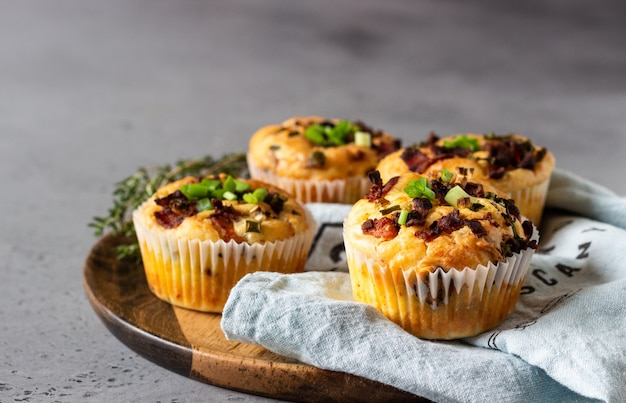 Savory muffins with bacon, quail egg, green onion cheese
