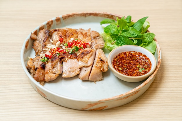 Savoury grilled chicken with chilli and garlic on plate