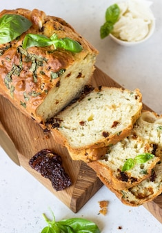 Savoury loaf cake with dried tomatoes, mozzarella and basil. selective focus.