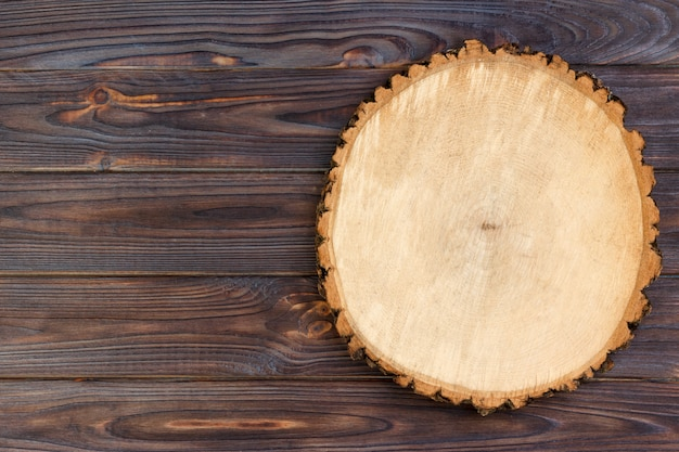 Sawed wood on a wooden background. top view, copyspace