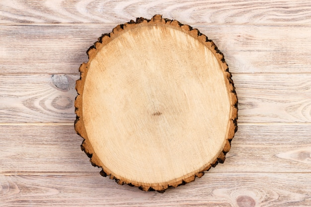 Sawed wood on a wooden background. top view